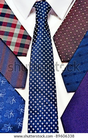 Neck ties stack on a white shirt - stock photo