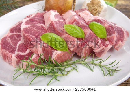 neck with rosemary and basil on white plate - stock photo