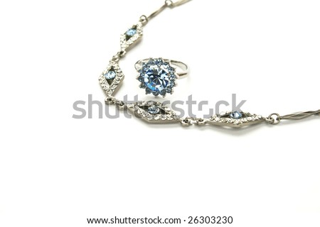 Necklace and ring with gemstones isolated on white background.