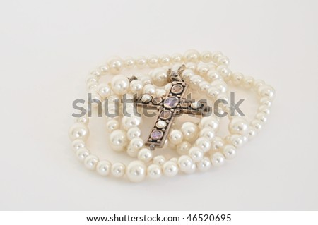Necklace cross and pearls - stock photo