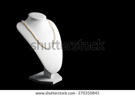 Necklace made of natural pearls on a stand. Women accessories - stock photo