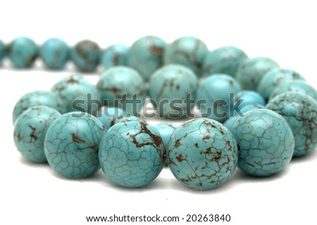 Necklace made of natural stone, isolated in white background - stock photo