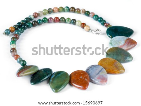 Necklace made of semi-precious gems on white background - stock photo