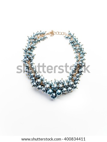 necklace of beads and gold chains isolated - stock photo