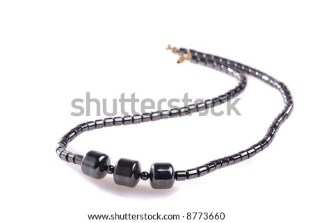 necklace of onyx beads isolated on white
