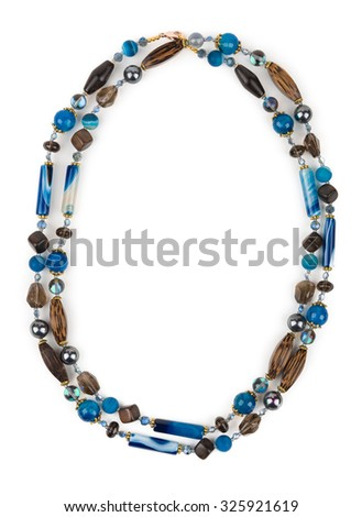 Necklace of topaz and chalcedony on white background. - stock photo