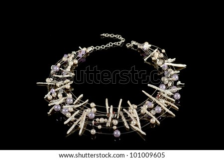 Necklace on a black background. Hand made. - stock photo