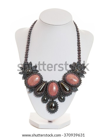 necklace on a mannequin isolated on white - stock photo