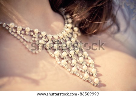 necklace on the neck of bride - stock photo