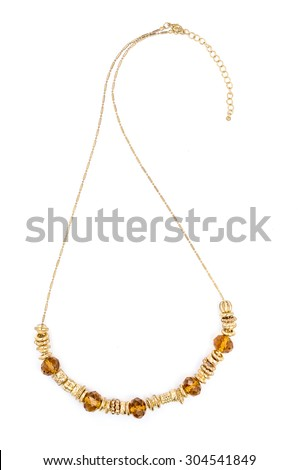 necklace with amber beads on white background - stock photo