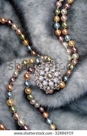 Necklace with brooch on fur - stock photo