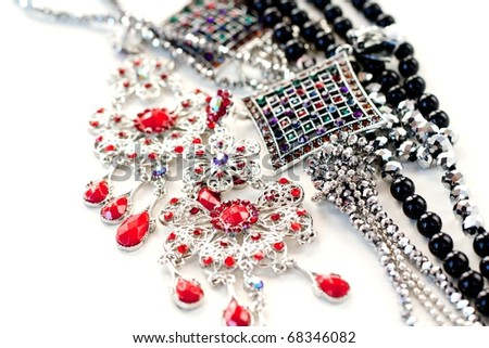 necklaces and earring on a white background - stock photo