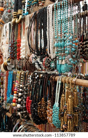 Necklaces for sale at a market - stock photo
