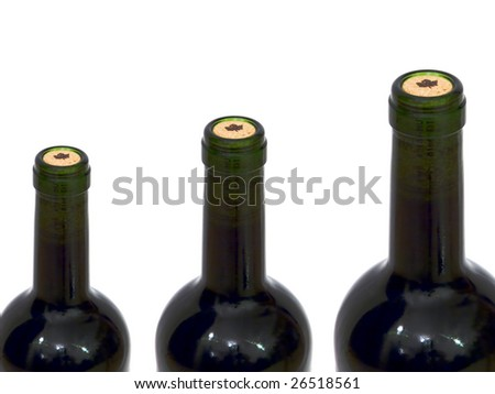 Necks of three bottles of wine on white background