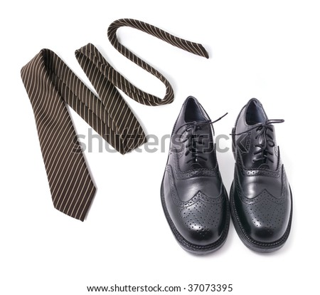 Necktie and Shoes on Isolated White Background - stock photo