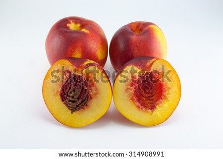 Nectarine fruit isolated on white background .