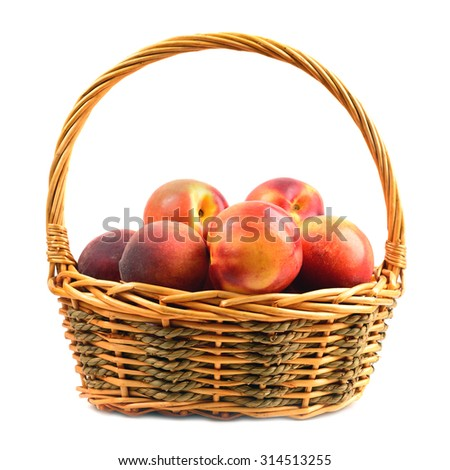 nectarines and peaches in basket isolated over white  - stock photo