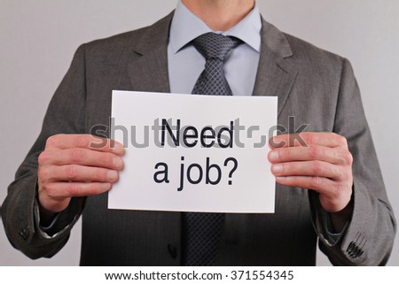 Need a job. Close up of businessman showing card.  Business, teamwork and finance concept. - stock photo