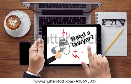 Need a lawyer?, on the tablet pc screen held by businessman hands - online, top view - stock photo