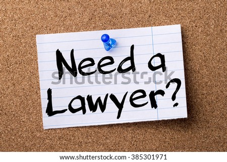 Need a Lawyer? - teared note paper pinned on bulletin board - horizontal image - stock photo