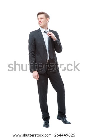 Need to relax. Full length of attractive young business man taking off his necktie. Isolated on white. - stock photo