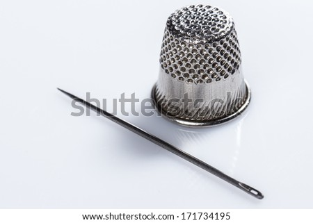 Needle and finger guard on white background