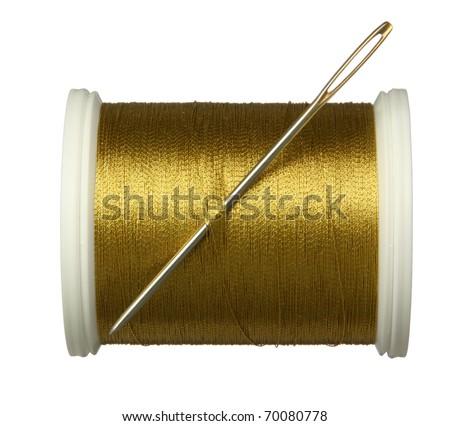 needle and golden thread. - stock photo