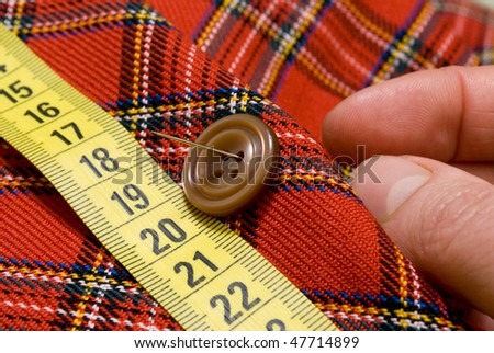 Needle and sewing button - stock photo