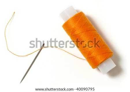 Needle and thread isolated over white background - stock photo