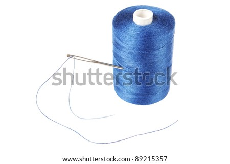 Needle in a coil of thread. On a white background. - stock photo
