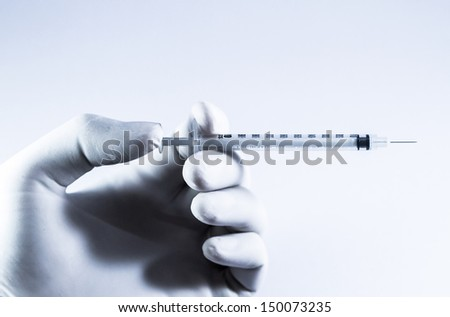 Needle injection holding by hand on the white background. - stock photo