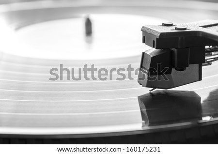 Needle over vintage record player. Music concept. - stock photo
