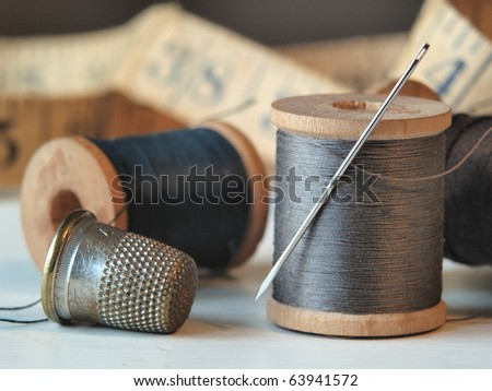 Needle, Thread and Thimble - stock photo
