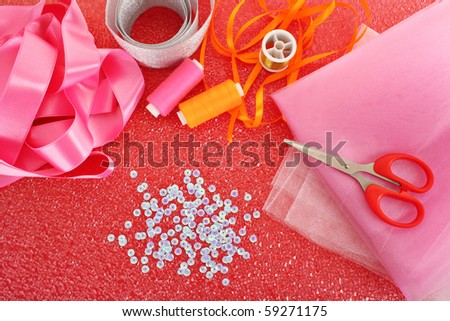 needle, threads, scissors, ribbons  and measuring tape - stock photo