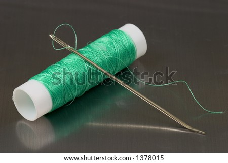 Needle with green thread