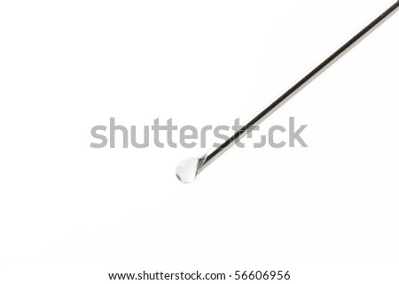 needle with liquid drop on white background