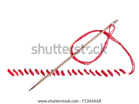 Needle with red thread and seam on white background - stock photo