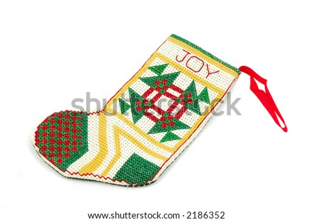 Needlepoint stocking ornament isolated on a white background