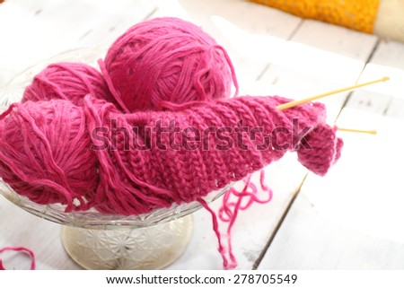 needlework balls of a knitting yarn with initial knitting and spokes