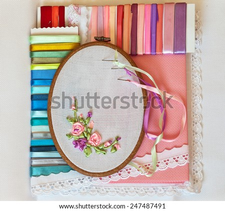 Needlework. Embroidery ribbons. Accessories: canvas, tambour and kit of satin ribbons - stock photo