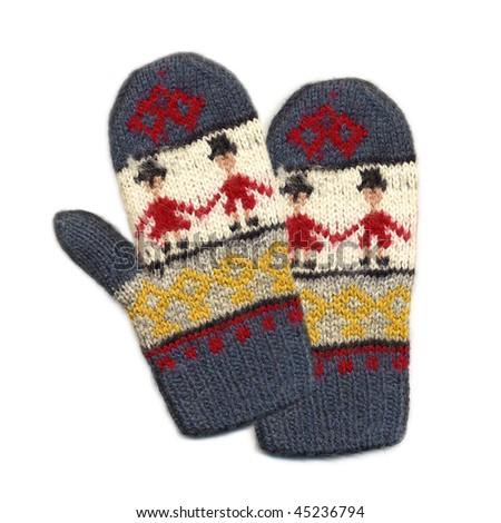 Needlework. Knitted mittens - stock photo