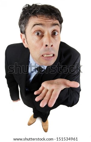 Needy business man begging, pleading his cause or showing his ignorance holding out the empty palm of his hand while looking expressively up at the camera isolated on white - stock photo