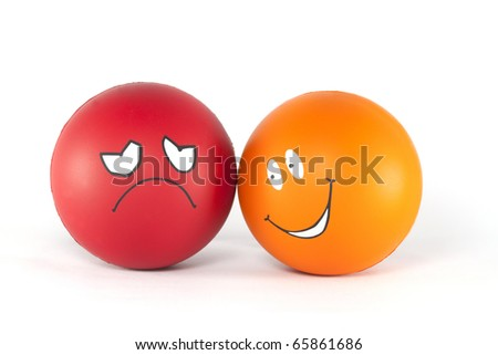Negative and positive emotions - tow balls. - stock photo