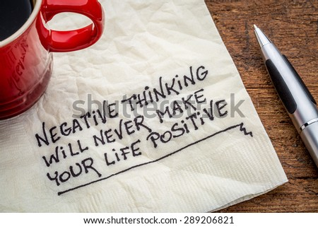negative thinking will never make your life positive - inspirational handwriting on a napkin with a cup of coffee - stock photo