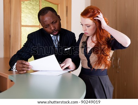 Negotiations between red-haired girl and black american man - stock photo