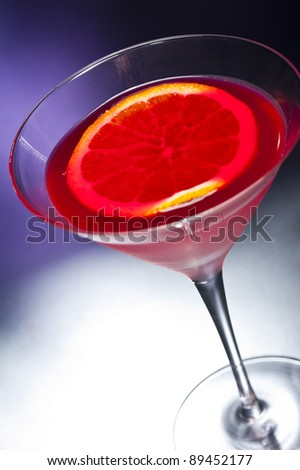 Negroni cocktail in front of different colored backgrounds