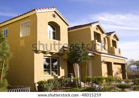 Neighborhood view of suburban homes - stock photo