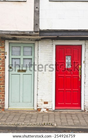 Neighbouring red and blue front doors - stock photo