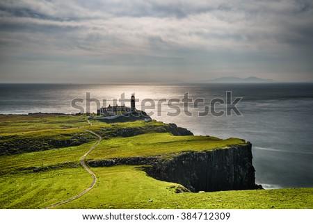 Neist Point lighthouse at Isle of Skye, Scottish highlands, United Kingdom - stock photo