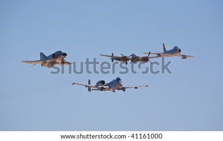 NELLIS AFB, LAS VEGAS, NV - NOVEMBER 14: F-4 Phantom, A-10 Thunderbolt, P-38 Lightning and F-86F Sabre fly in formation at Aviation Nation 2009 on November 14, 2009 in Nellis AFB, Las Vegas, NV - stock photo